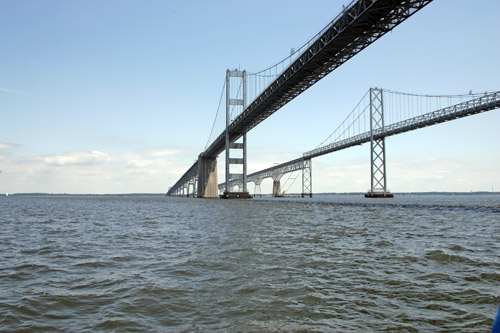 Sailing under the twin spans of the Chesapeake Bay Bridge.